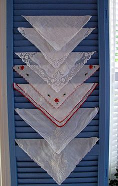 lovely way to display vintage hankies. buy vintage hankies here: http://www.nanaluluslinensandhandkerchiefs.com/