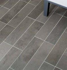 Beautiful charcoal grey coloration.  Honed Grey Foussana Limestone 12x24.