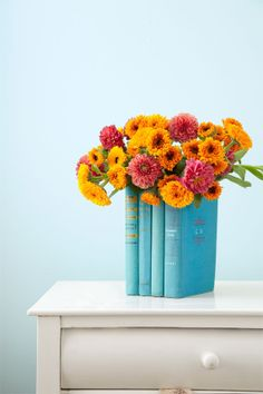 Give damaged books a new lease on life by transforming them into a bookish vase. #WomansDay
