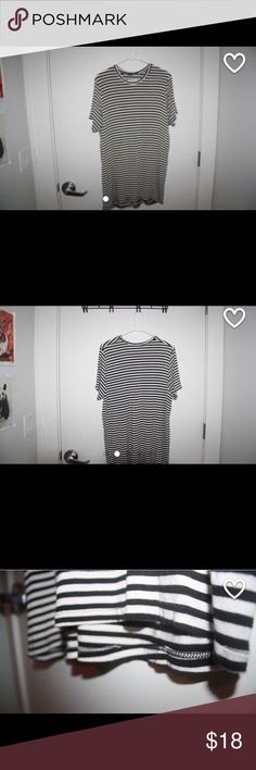 Brandy Melville dress Brandy Melville black and white striped, casual, black t-shirt dress. Super comfortable and basic so it's easy to style. This has only been worn one time, in perfect condition! Brandy Melville Dresses Mini