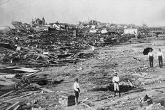 Hurricane results in Galveston, TX 1900. Utter destruction, but with Bishop's Palace still standing in the background.