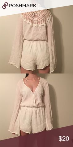White bathing suit cover up romper Perfect for the beach or pool. White romper. Low cut in the front with a snap up button. Floral lace in the back. Forever 21 Pants Jumpsuits & Rompers