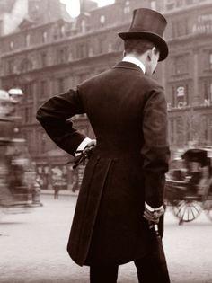 Gentleman in top hat and over coat