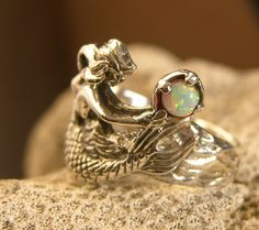 "Silver Mermaid Ring with Opal. (no longer available from ""Freedom from Jewelry"" on Etsy, but the artist might make a custom one!"