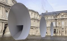 Picking up from where the mirrored monument that held Dior's latest haute couture show left off, the Musée du Louvre's Cour Carrée was inhabited by another reflective box, this time inserted with three curvilinear piped runways for the maison's A/W 2...