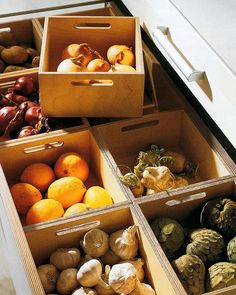 Small pull out crates store non-refrigerated produce and allow for easy access while keeping counters clutter free.