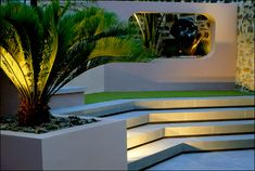 Modern Terraced Garden - i like the steps... leading to raised decking with tables looking out to sea