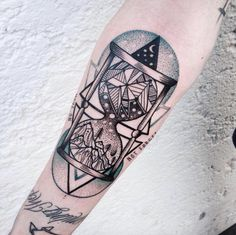 Complex hourglass tattoo by Jessica Svartvit