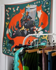 Karen Mabon Scarves hanging up for inspiration and Scarf School. Love the fox print design.