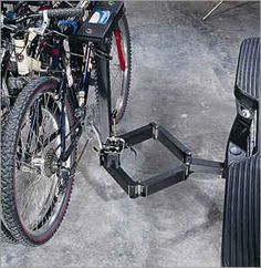 This innovative bicycle hitch rack glides away to the side of the vehicle, allowing easy access to the rear cargo area. It eliminate...