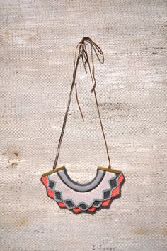 Harlequin knitted necklace - Bright Coral. £24,00, via Etsy.
