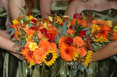 fall bridesmaid bouquets---gerbera daisies, hypericum berries, roses (yellow & orange), crocosmia, Eucalyptus and just ignore the sunflowers:-)