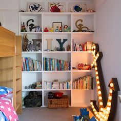 Storage shelves for children  In children's rooms, fitted storage will encourage tidiness and make the most of all the available space.  Bespoke fitted storage - Neville Johnson