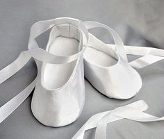 White baby girl shoes are very comfortable and convenient for little fashionistas. Satin shoes are classy and elegant. Perfect for any special occasion - wedding, baptism, birthday party. When its time to step out in precious style, this darling pair of satin baby shoes has baby covered from heel to toe. A soft feel and ribbon bow tie will have little ones ambling about with smiles and delight. Shoes are soft soled! Inside lined with cotton. Simple and concise booties are the finishing touch…