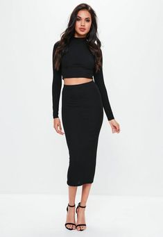 This black midaxi skirt features ribbed fabric, high waist fit and fitted style.