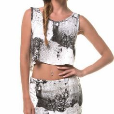 "UO SomeDays Lovin Marble Jersey Crop Tank Urban Outfitters Somedays lovin Excalibur crop tank *Black and white marble like patterns  *Loose fit  *Size small *Pit to pit : 20"" flat / Length : 17"" *95% Viscose / 5% spandex - super soft! *New with a tag Urban Outfitters Tops Crop Tops"