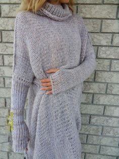 Copyright © 2013-2017 Roseuniquestyle. All rights reserved.  Slouchy / Oversized knit tunic. Loose knitted, relaxed fit. Color is a mix of mid and light grey.  Also available in charcoal grey, black and cream colors.  Made of cotton blend. There are thumb holes in the sleeves for easy wearing. If you do not wish thumb holes please let me know when you place an order.  Please choose your size on your upper right.  Size Small will fit sizes 2-6 US. Size Medium will fit sizes 8-12 US. Size ...