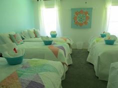 I made the wall hanging and the throws on the beds for the Hidden Star Retreat.  Here's the Turquoise Bedroom- sneak peek