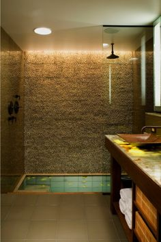 Zen sunken bathtub with shower More