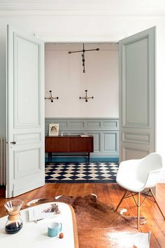 Entrance hall and living room in blues, whites, and wood // Old French home with fresh colour | Inside Out magazine, February 2016 // Photograph: Julien Fernandez