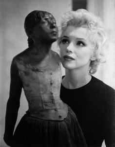 Marilyn admiring Degas' Little Dancer statue, 1956