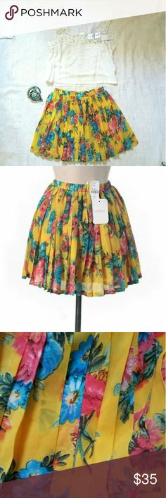 "NWT LF Yellow Floral Millau Pleated Mini Skirt New w/ tags. Beautiful yellow mini skirt w/ blue & pink floral print. Pleated all over. Girly & feminine. Elastic waist. 100% Polyester. Retailed for $132 at LF. By Millau. Sz S. Approx measurements: 15"" length, 12"" unstretched waist, 17"" max stretched waist. Last pic shows similar skirt modeled in different print. I'm also selling the LF Millau top in covershot. LF Skirts Mini"