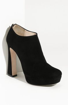 I'm kind of coveting these, although they would make me 6 feet tall, and I might break my ankle looking so cool...
