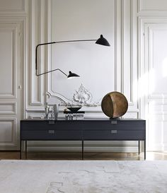 Amazing black console table and well designed. Discover more: modernconsoletables.net | #consoletables #modernconsoletable #contemporaryconsoletable