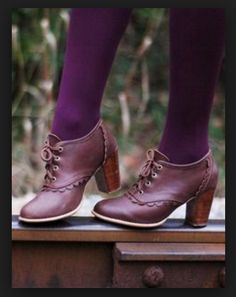 Great use of color! Rich, almost eggplant leather with purple/red/aubergine tights.