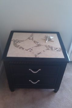 diy side table:  1) get broken floor tiles from home improvement store (they will usually give them to you for free)  2) arrange into inset top  3) fill gaps between tiles with mosaic tile  4) grout and seal  5) paint with semi gloss black and spraypaint handles silver