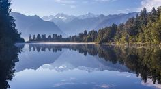 2015 Lake Matheson New Zealand.  AKA Mirror Lake... guess why... #Reflection #Lake #NewZealand #Mirror #Travel  Lake Matheson near the Fox Glacier in South Westland New Zealand is famous for its reflected views of Aoraki/Mount Cook and Mount Tasman.