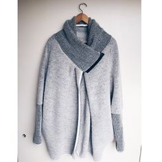 Soft Gray Coat with Cowl Neck Thick sweater like material with a high neck to keep you warm. It has a black zipper about a foot long that makes it overlap to close it. Worn twice. Bought in a small boutique in Paris, France.   *ALL SALES DIRECTLY HELP PAY FOR MY HUSBAND AND I TO DO ORPHAN CARE IN KENYA, AFRICA Jackets & Coats