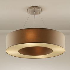 polished chrome metalwork in combination with a handmade lamp shade vailable in different fabrics and colours. chelsom.com