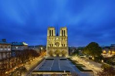Notre Dame Cathedral is particularly beautiful at dusk when its glow can be seen even from afar. - Ag photographe/Moment/Getty Images