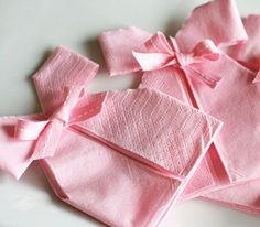 Napkin folding for Baby showers...have made these in white with blue or pink ribbons...these are cute