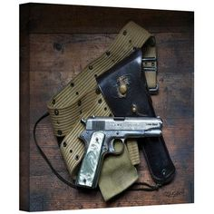 "ArtWall Colt and Holster' by Antonio Raggio Photographic Print on Wrapped Canvas Size: 24"" H x 24"" W"