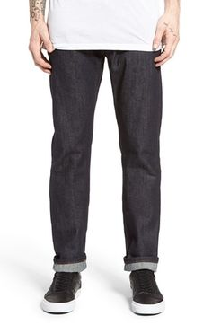 Free shipping and returns on The Unbranded Brand UB201 Tapered Fit Raw Selvedge Jeans at Nordstrom.com. Contrast orange stitching classically styles dry selvedge denim jeans in a dark, clean indigo wash with a slim, tapered fit. Raw denim is stiff at first, but will soften with time and wear. Those in the know suggest sizing down and washing very infrequently. That will allow the denim to conform to your shape and take on the personal wear lines and fading unique to you.