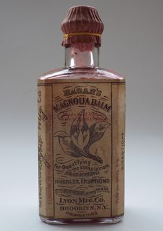 """Antique Bottles 25 - March - Cirencester, Gloucestershire. Magan's Magnolia Balm. A full, sealed, embossed and labelled American skin lotion with a London overprint on the label standing 5.3"""" tall,"""