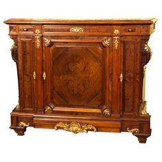 """Dore bronze mounted 19th century marble top server showing the quality of the finest cabinet makers of the period using exceptional rosewood veneer. CIRCA: 19th Century DIMENSIONS: 44"""" h x 4' 4"""" w x 18"""" d"""
