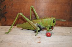 "Hubley Cast Iron Grasshopper Pull Toy - Super  Rare 1920's era 11 1/2"" version by InTheBluffs on Etsy https://www.etsy.com/listing/217656017/hubley-cast-iron-grasshopper-pull-toy"