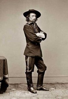 General George Custer, U.S.A.  murderer of  unharmed woman and children and even infants...what a disgrace to even have his picture up here;