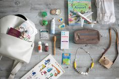 Flying with toddlers, requires a lot of planning. Head over to Nika Kai Travels to see the full list of what we pack in our bag (s). Snacks, entertainment and extras for the moms are just some of the things.
