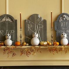 Sugar pumpkins, stacked as skeletons, rest in peace on a macabre mantel. #halloween