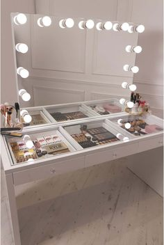 crisp white finish Slaystation make up vanity withpremium storage, threespacious drawers encrusted with diamanté cut light reflecting glass handles topped with a show-stopping 15 frosted bulb Hollywood Mirror
