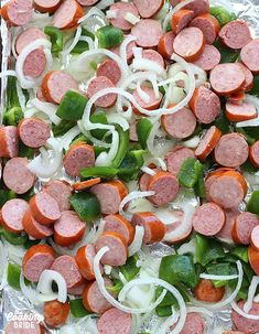 It doesn't get more convenient than quick and easy sheet pan dinners. Smoked sausage is seasoned with Cajun seasoning and roasted with green bell peppers and sliced onions. Smoked Sausage And Peppers Recipe, Smoked Sausage Recipes, Onion Recipes, Pork Recipes, Healthy Recipes, Roasted Onions, Roasted Peppers, Green Pepper Recipes, Recipes