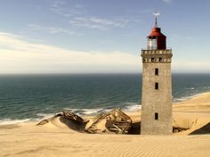The Rubjerg Knude Lighthouse in Jutland, Denmark, in the process of being engulfed by sand dunes.  It was abandoned in 1968.