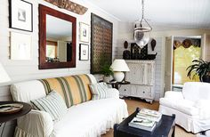 """In the sunroom and throughout the rest of the house, Frank mixes light and dark pieces to create a liveliness that legendary decorator Nancy Lancaster called """"movement."""""""