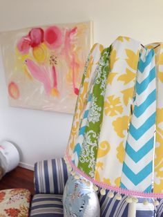 Make your own bespoke lampshade by knotting pieces of scrap fabric around an old wire frame. Add some Pom Pom trim and vahlaa!