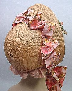 1860s straw bonnet - pink trim - note the binding at the bottom