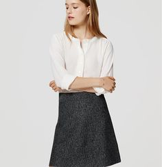 """Chic and easy, this sweater flippy skirt gets smart with a speckled tweed-effect texture. Elasticized waistband. 19 1/2"""" long."""